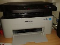 Samsung three in one Printer, Photo copier and scanner with free brand new laser cartridge