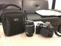 Nikon D3100 DSLR Camera with AFS 18-55 mmVR lense.