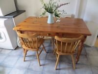 Pine table and four chairs for kitchen or dining room.