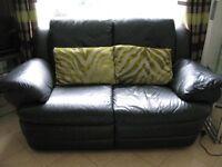Natuzzi black leather 2 & 3 seater settees