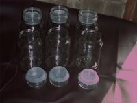 six glass airtight jars.