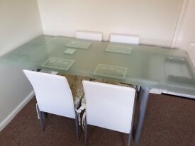 Glass extending table and 4 chairs