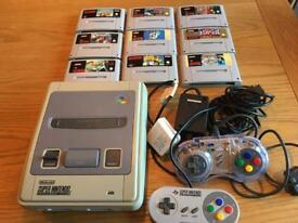 Super Nintendo with 9 Games and 2 Controllers!
