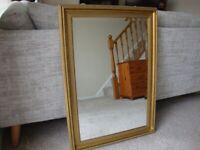 A LARGE WALL MIRROR FOR SALE