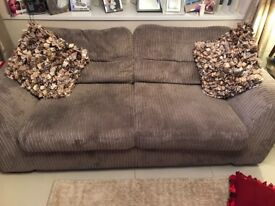 Grey Two seater couch, and cuddle chair also grey..