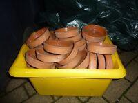 Small ceramic pot saucers.