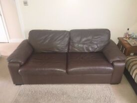Two leather sofas...One large sofa bed and a double sofa