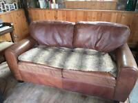 Leather three seater sofa (very old John Lewis)