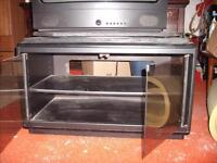 TV stand with swivel top and storage area