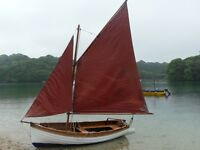 McNulty 12ft gaff rigged sailing dinghy.