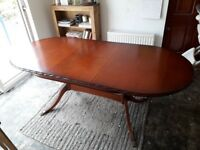 Perfect condition oval dark stained varnished wooden extending table with 8 super comfy chairs.
