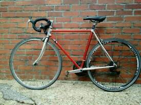 Vintage Peugeot Aluminium framed road bike, red