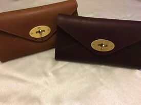 mulberry purple and tan purses