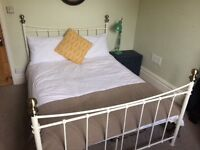 Cream metal double bed and mattress