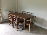 Oak refectory table with six ercol chairs
