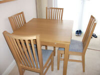 IKEA Bjursta extendable table and 4 matching chairs