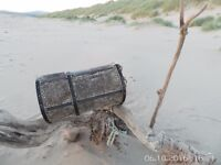 TWO INTERESTING RUSTIC GARDEN ORNAMENT SHRIMP OR LOBSTER POTS COMPLETE WITH BUOYS AND OLD ROPE