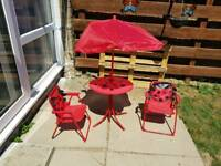 Child's garden table and 2 chairs