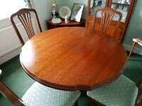 Cherry wood dining table with chairs and glass display cabinet