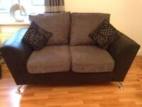 2x2 black and grey sofas bought from scs