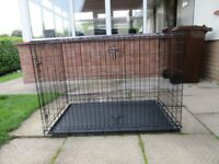 2 Dog Crates - X-Large & Large. As new. 2 doors. Easy fold for storage. Very strong but lightweight.