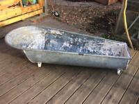 Antique galvanised metal bath