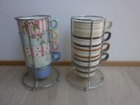 Two sets of M&S Mugs in stainless steel holders