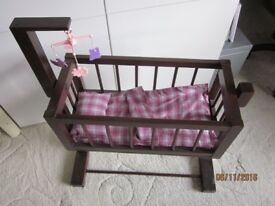 Wooden rocking doll's crib with accessories, ideal toy / collector's item