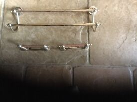 Double antique brass towel rail and two matching toilet roll holders