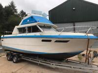 Flybridge power boat on trailer