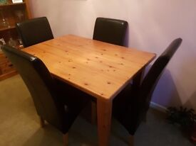 Solid wood dining table with leather chairs and matching shelving unit