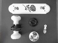 Ceramic door furniture with black rose motif