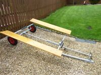 Inflatable boat launching and storage trailer with extension tow bar