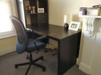 Desk with shelving unit and chair