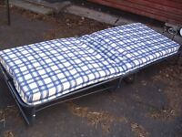 folding guest bed, folding bed frame with metal slats, upright folding hire bed