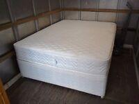 Double divan bed.