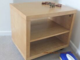 Small wooden cube-like shelf unit on casters
