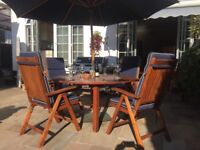 Teak table and 6 reclining chairs with seat pads + umbrella