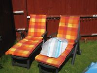 2x Green plastic sun beds with matching cushions
