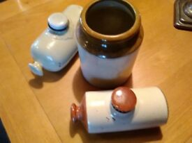 2 stoneware hot water bottles and stoneware jar. Nice decorative items.