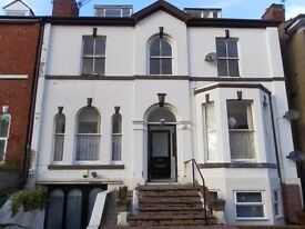 A well-presented 2 bed top floor apartment with parking, town centre, quiet location, viewing recomm