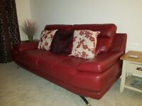 2x Red leather sofas, 2mtr long and as new.Still selling at Harvey's for £500 each.