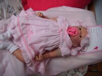 Reborn doll un-named with certificates. 6 month old.