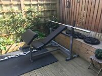 Weights bench and 145kg weights