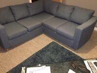 Small corner suite, denim blue colour fabric.