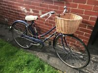 Vintage women's bicycle. Blue and white Rotary bike.