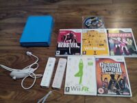 Nintendo wii console 2 remotes and 6 games