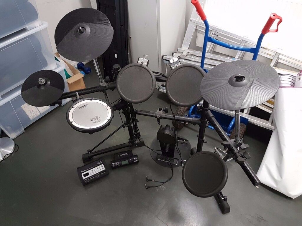 Roland TD-4 and TD-3 electronic drum kits with option for extra pads.