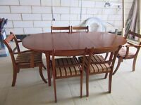 Oval Extending dining table, 4 chairs and 2 carvers.