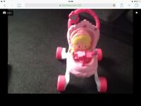 Pink walker with doll practically brand new
